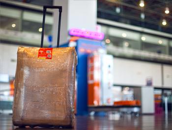 Makina për mbështjelljen e valixheve